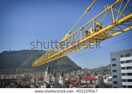 Part of yellow construction tower crane