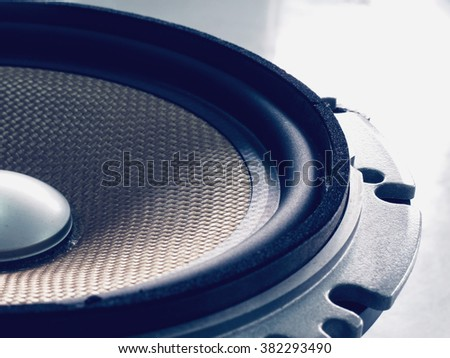 Part of yellow old car audio speaker, vintage filtered effect - stock photo