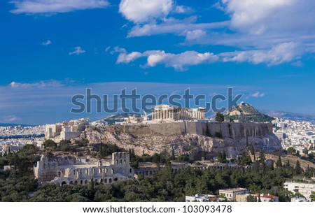 Parthenon of Athens, Odeum Of Herodotus and Lycabetus Hill in Greece against a blue sky, shot in the afternoon with wide angle lens - stock photo