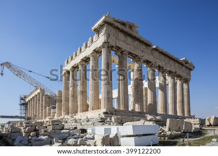 Parthenon temple on the Acropolis in Athens with construction crane. - stock photo