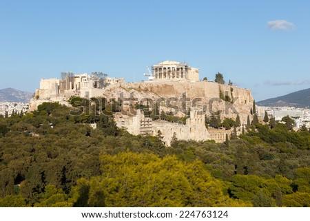 Parthenon temple on the Acropolis of Athens, dedicated to the maiden goddess Athena  - stock photo