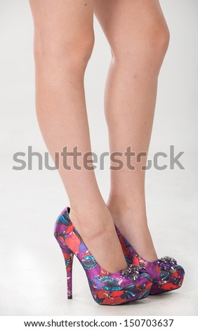 Partial of a woman's legs and shoes