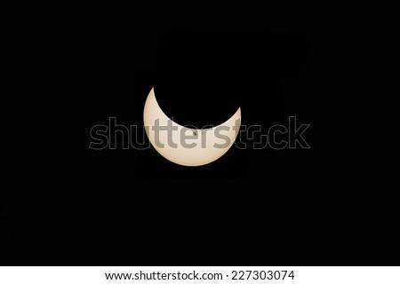 Partial solar eclipse - stock photo