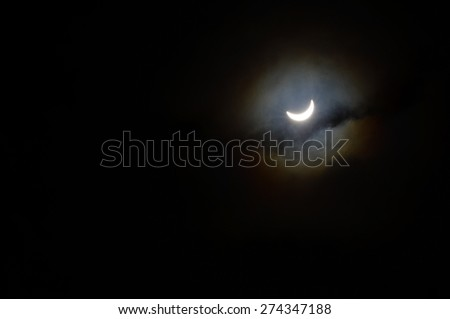Partial solar eclipse of the sun which happened on the 20th March 2015. - stock photo