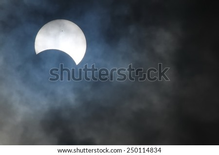 Partial Solar Eclipse on a Cloudy Day 03.11.2013 - stock photo