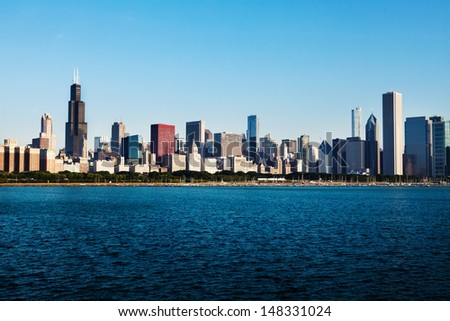 Partial view of Chicago skyline over Lake Michigan early morning  - stock photo