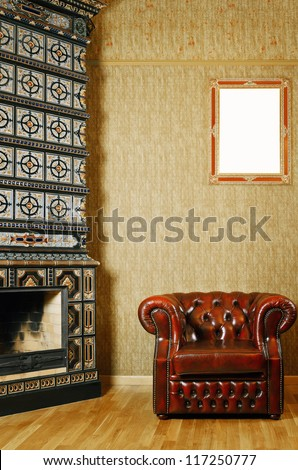 Partial View Of The Apartment With Chair And Fireplace