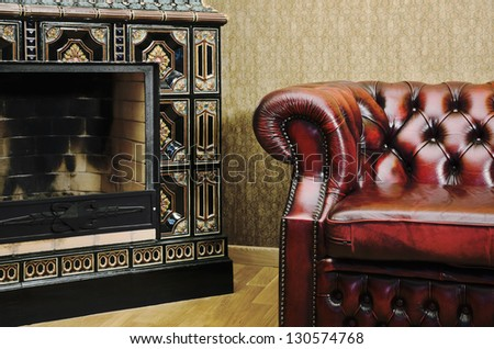 Partial View Of The Apartment With Chair And Fireplace - stock photo