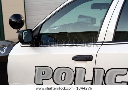 Partial view of the driver's side of a police car.