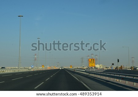 Partially completed modern highway (express way) with road diversion, speed limit signs etc. and traffic cones