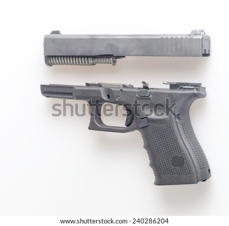 partially disassembled handgun - stock photo