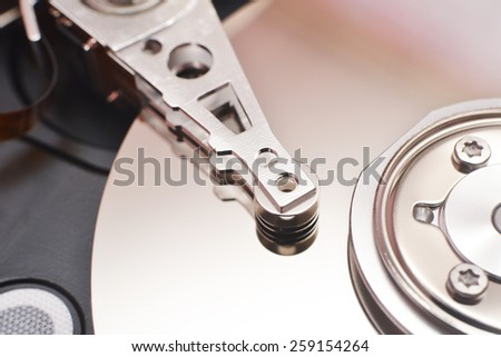 Partially view of disassembled hard disk drive - stock photo