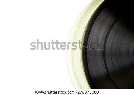 Partially visible 35mm movie film roll isolated on white background with copy space - stock photo