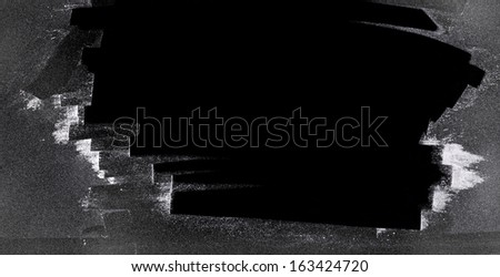 partly clean scratched frost covered black surface - stock photo