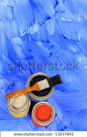 Partly finished blank blue painted floor with paint cans and paintbrush.  Space for copy. - stock photo