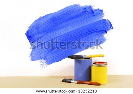 Partly finished blue painted wall with paint can and paintbrushes.  Space for copy. - stock photo