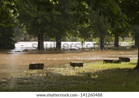 Partly flooded park area after weeks of rain. - stock photo