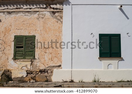Partly restored decaying facade, an old vs. new concept - stock photo