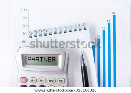 Partner - Financial accounting stock market graphs analysis. Calculator, notebook with blank sheet of paper, pen on chart. Top view - stock photo