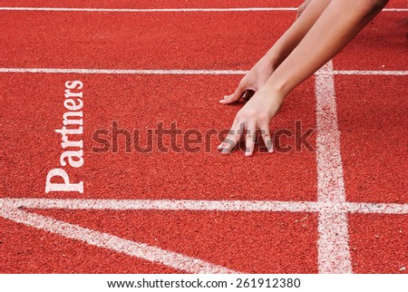 Partners - hands on starting line - stock photo