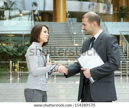 partners handshaking - stock photo