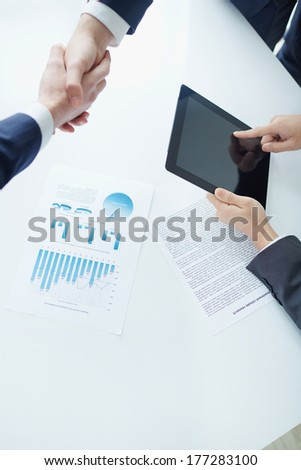 Partners shaking hands after successful negotiations  - stock photo