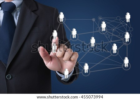 PARTNERSHIP Businessman hands touching on virtual screen and blurred city background