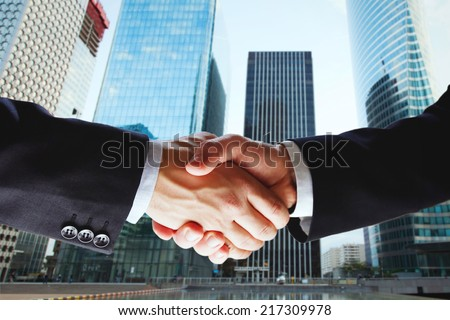partnership, cooperation of two companies, deal of two businessmen - stock photo