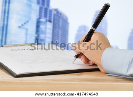 Partnership signing contract with city background. Concept of business deals, agreement. - stock photo