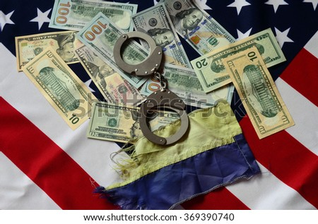Partnership. USA and Ukraine Flag with handcuffs and money - stock photo