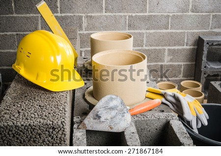 Parts and tools for the construction of modular ceramic chimney in the house - stock photo