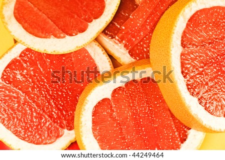 Parts of a red grapefruit close up