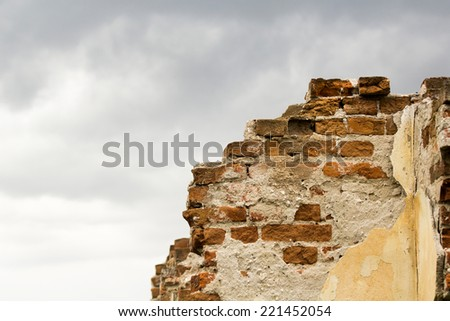 Parts of a ruined house with dramatic sky - different textures  - stock photo