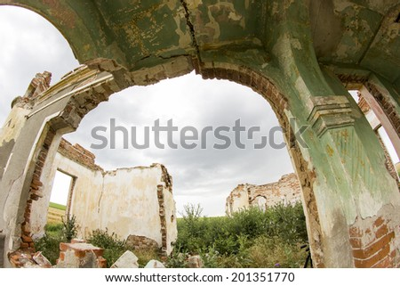 Parts of a ruined house with dramatic sky - different textures and herbs. Fisheye lens effect  - stock photo