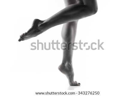 Parts of body.  Ballet dancer legs over white - stock photo