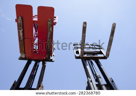 Parts of forklift loader for warehouse works outdoors - stock photo