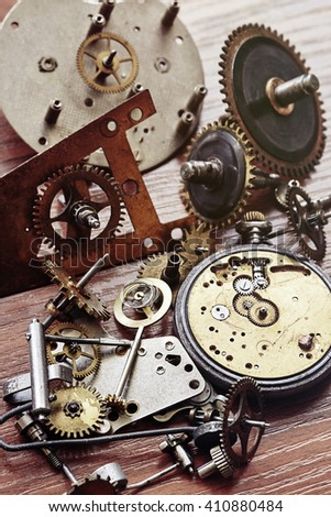 Parts of mechanical watch and alarm clock - stock photo