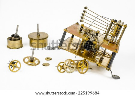 parts of old clockwork (pendulum clock) - stock photo