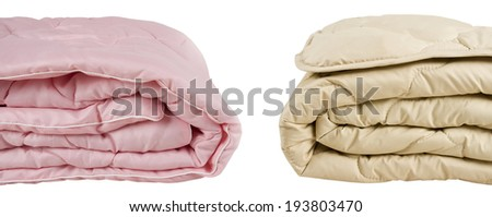 Parts of pink and beige blankets isolated on white background - stock photo