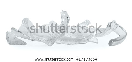 Parts of the broken glass jar isolated on white background. - stock photo
