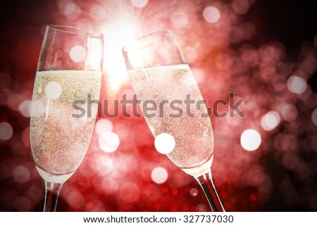 party and red space of glasses of champagne  - stock photo