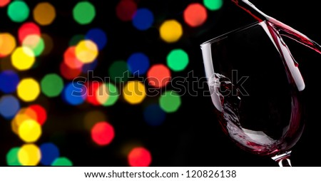 party background with Red wine splashing on a black