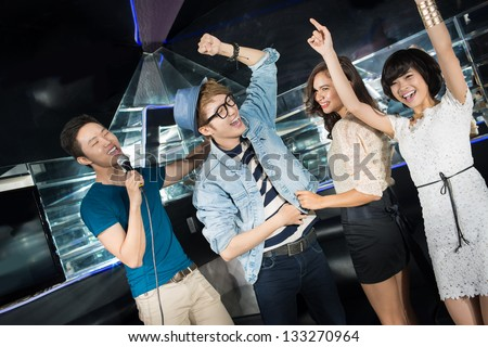 Party being in full swing, clubbers enjoying themselves - stock photo