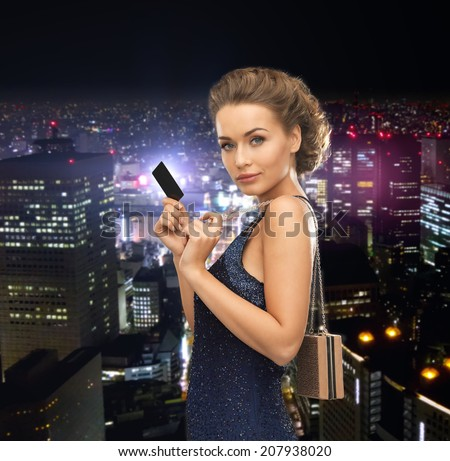 party, celebration, holiday and banking concept - beautiful woman in evening dress with small bag and vip card - stock photo