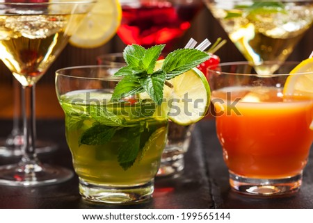 Party cocktails and longdrinks garnished with fruits for summer - stock photo