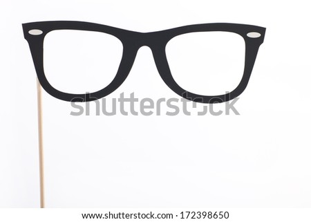 Party costume or decoration of heavy rimmed glasses or spectacles in a black silhouette mounted on a stick isolated on white with copyspace