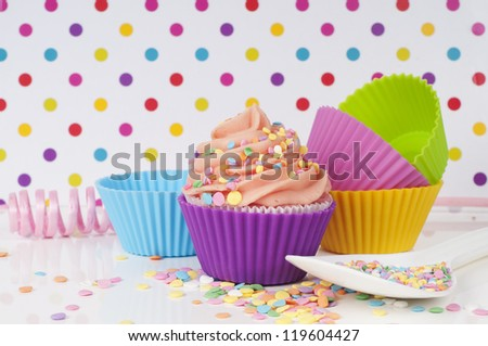 party cupcake setting with sprinkles and empty cups