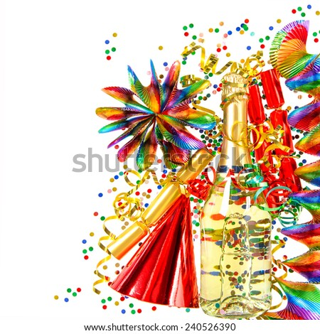 party decoration with garlands, streamer, cracker, confetti and wine bottle. holidays background - stock photo
