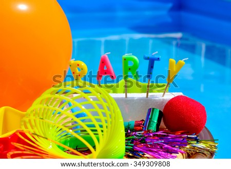 Party decorations on the swimming pool background