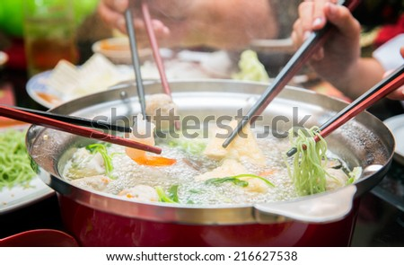 Party family with hot sukiyaki - stock photo